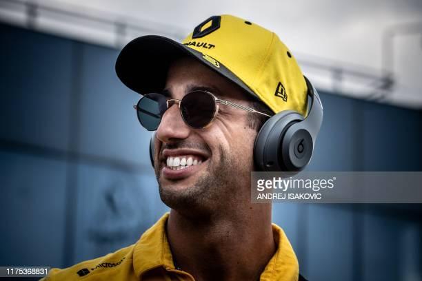 Renault's Australian driver Daniel Ricciardo listens to music ahead of the Hungarian Grand Prix at Hungaroring circuit in Mogyorod near Budapest on...