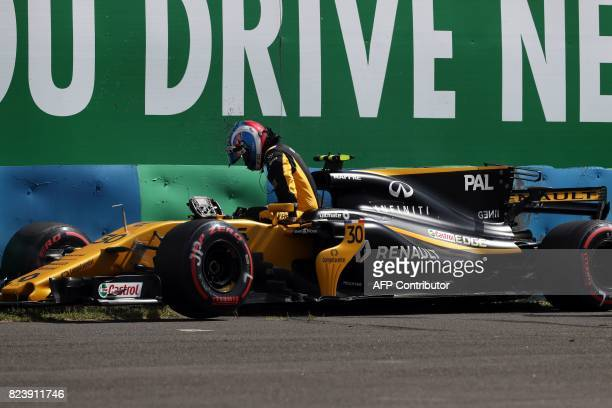 Renault's British driver Jolyon Palmer leaves his car after he crashes during a practice session at the Hungaroring racing circuit in Budapest on...