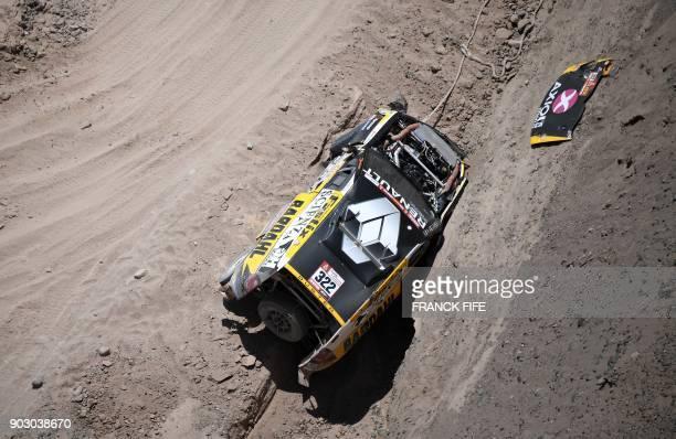 Renault's driver Emiliano Spataro and codriver Santiago Hansen of Argentina crash during Stage 4 of the Dakar 2018 in and around San Juan De Marcona...