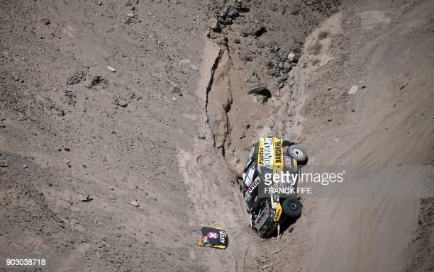 TOPSHOT Renault's driver Emiliano Spataro and codriver Santiago Hansen of Argentina crash during Stage 4 of the Dakar 2018 in and around San Juan De...