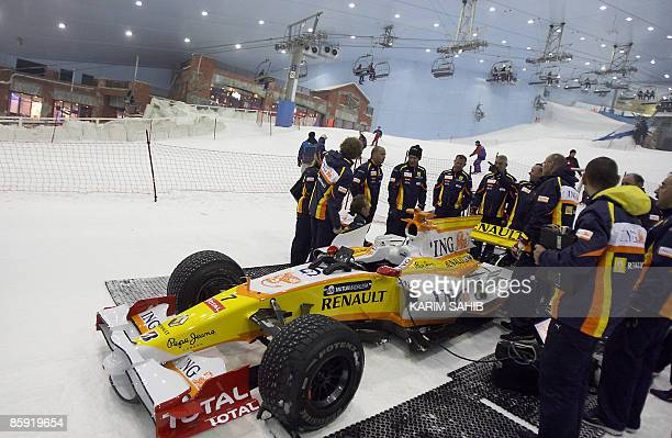 Renault's Formula One crew prepare the R29 for Brazilian driver Nelson Piquet during a promotional event for the car manufacturer at the indoor ski...