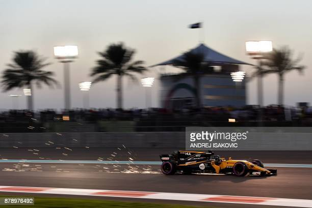 Renaults German driver Nico Hulkenberg steers his car during the qualifying session ahead of the Abu Dhabi Formula One Grand Prix at the Yas Marina...