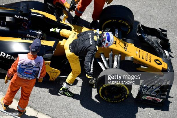 Renault's Russian reserve driver Sergey Sirotkin gets out of his car during the first practice session of the Formula One Russian Grand Prix at the...