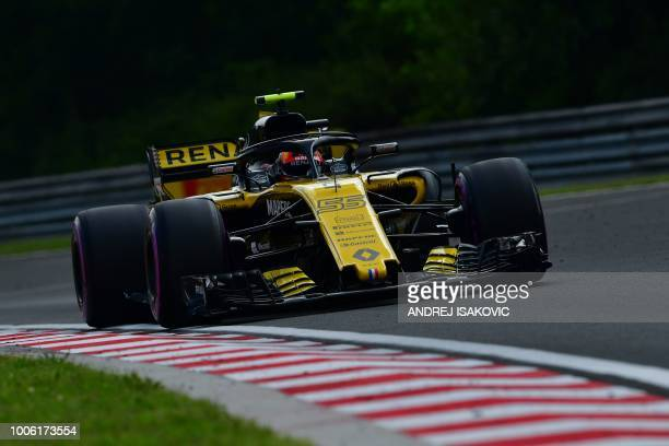 Renault's Spanish driver Carlos Sainz Jr steers his car during the second free practice session ahead of the Formula One Hungarian Grand Prix at the...