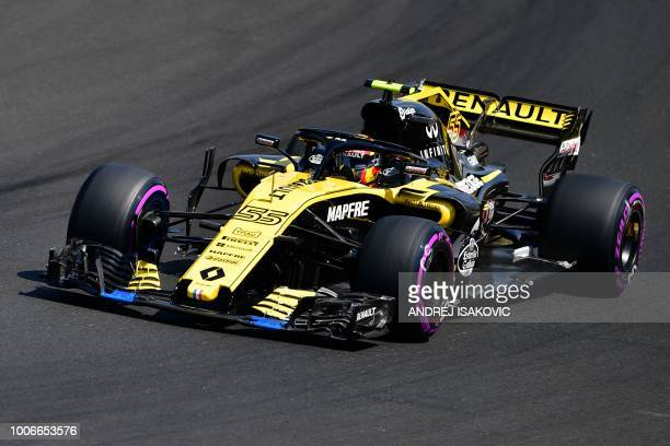 Renault's Spanish driver Carlos Sainz Jr steers his car during the third free practice session ahead of the Formula One Hungarian Grand Prix at the...