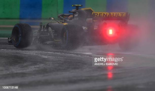 Renault's Spanish driver Carlos Sainz Jr steers his car during the qualifying session on the eve of the Formula One Hungarian Grand Prix at the...