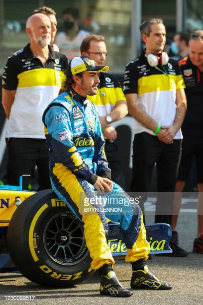Renault's Spanish driver Fernando Alonso sits on the wheel of his Renault R25 car ahead of his demonstration laps prior to the Abu Dhabi Formula One...