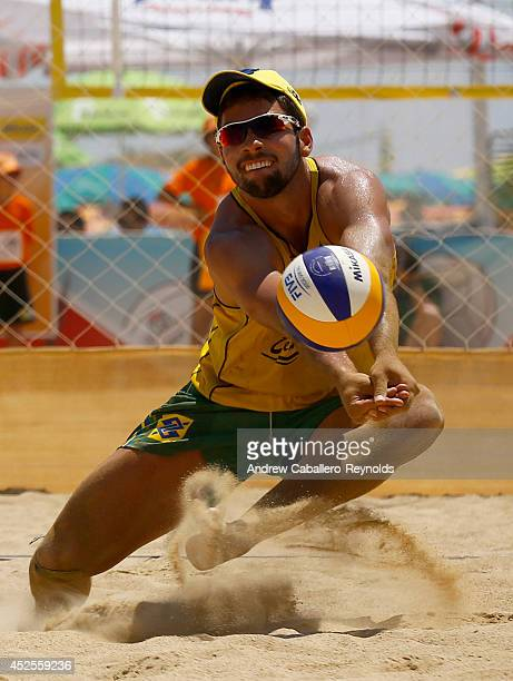 Renaux Morais Leonardo from Brazil dives for the ball at the FIVB Under 21 Beach Vollyball World Championships on July 23 2014 in Larnaca Cyprus
