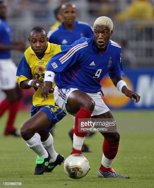 rench forward Djibril Cisse vies with Colombian defender Gonzalo Martinez during their soccer Confederations Cup first round match 18 June 2003 at...