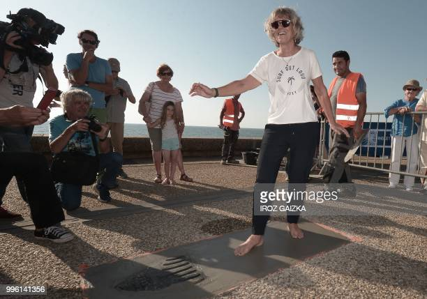 rench surfer Maritxu Darrigrand leaves her footprint cement slab as she takes part in the inauguration of the Anglet Surf Avenue with other surfers...