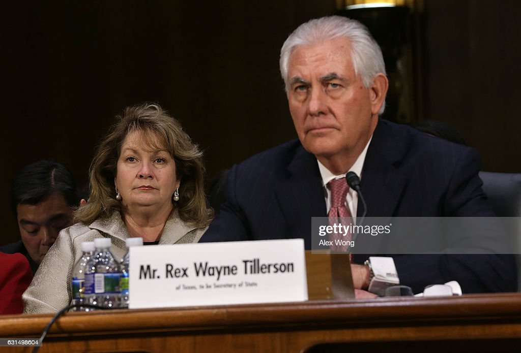 Renda Tillerson (L) listens during the confirmation hearing for her husband and former ExxonMobil CEO Rex Tillerson (R), U.S. President-elect Donald Trump's nominee for Secretary of State, before Senate Foreign Relations Committee January 11, 2017 on Capitol Hill in Washington, DC. Tillerson is expected to face tough questions regarding his ties with Russian President Vladimir Putin.