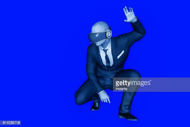 3D render of a businessman wearing virtual reality headset.