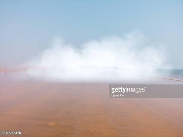 rendered clouds on the beach - liyao xie stock pictures, royalty-free photos & images