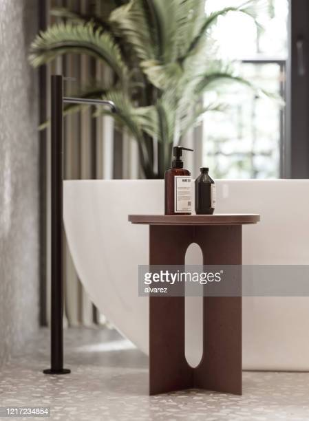 3d rendering of a bathroom with bathtub and toiletries - domestic bathroom stock pictures, royalty-free photos & images