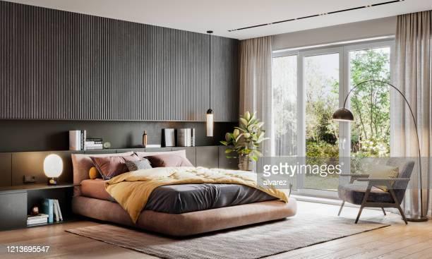 3d het teruggeven van een elegante slaapkamer - overvloed stockfoto's en -beelden