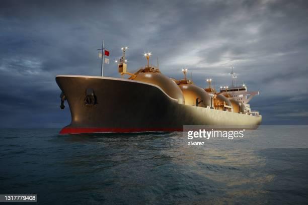 夜間に海上を航行するlngタンカーの3dレンダリング - 液化天然ガス ストックフォトと画像