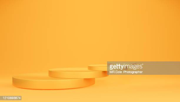 3d rendering yellow gold stage or podium for advertisement,blue backgrounds with copy space - copy space imagens e fotografias de stock