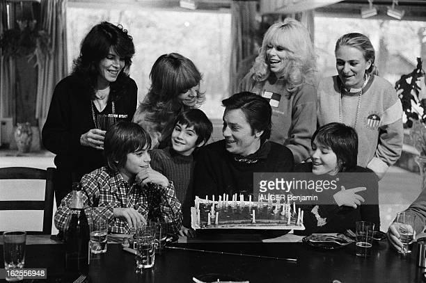 Rendezvous With Alain Delon For Its 41St Birthday Plan de troisquarts souriant d'Alain DELON devant son gâteau d'anniversaire après avoir soufflé les...