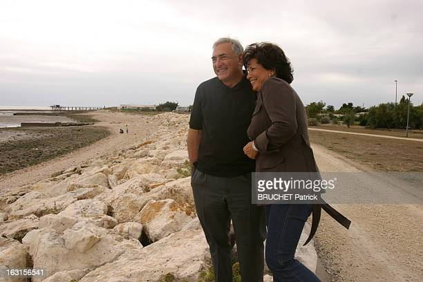 Rendezvous With Dominique StraussKahn And Anne Sinclair Dominique STRAUSSKAHN et son épouse Anne SINCLAIR riant se promenant sur la plage d'Ayrte en...