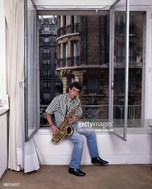 Rendezvous With Michel Boujenah At Home In Paris Paris octobre 1987 Portrait de Michel BOUJENAH chez luijouant du saxophone assis sur le rebord de la...