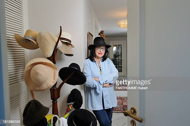 Rendezvous With Nana Mouskouri At Home In Geneva Nana Mouskouri attitude smiling 75 years old wearing a hat posing in the entrance of his apartment...