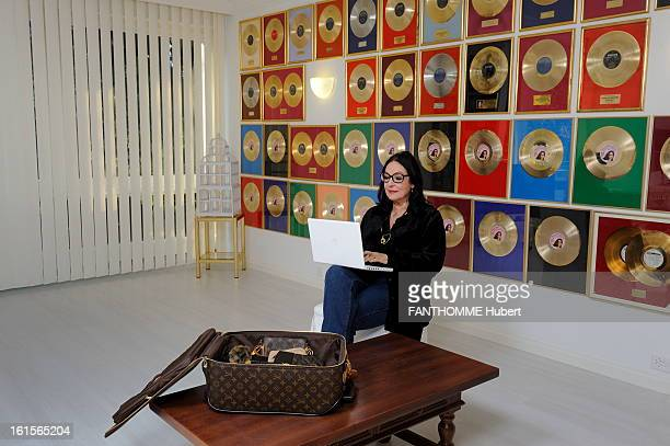 Rendezvous With Nana Mouskouri At Home In Geneva Nana Mouskouri smiling attitude of 75 years posing in his new office being in his apartment Layouts...