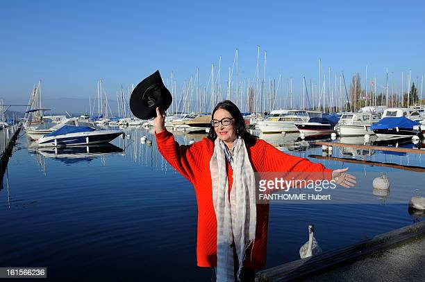 Rendezvous With Nana Mouskouri At Home In Geneva Nana Mouskouri smiling attitude of 75 years posing in Lake GENEVA his hat in his hand