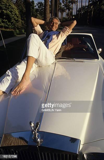 Rendezvous With Pierre Rey. Avril 1988, l'écrivain Pierre REY chez lui, à Los Angeles, en Californie. Il pose allongé sur sa voiture, une Rolls...
