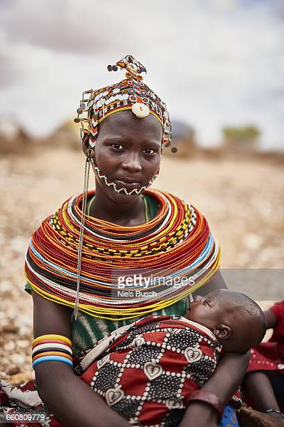 rendille tribal woman portrayed with baby - african tribal culture stock pictures, royalty-free photos & images