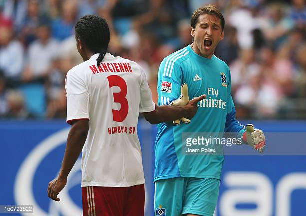Rene Adler and Michael Mancienne of Hamburg celebrate during the Bundesliga match between Hamburger SV and 1 FC Nuernberg at Imtech Arena on August...