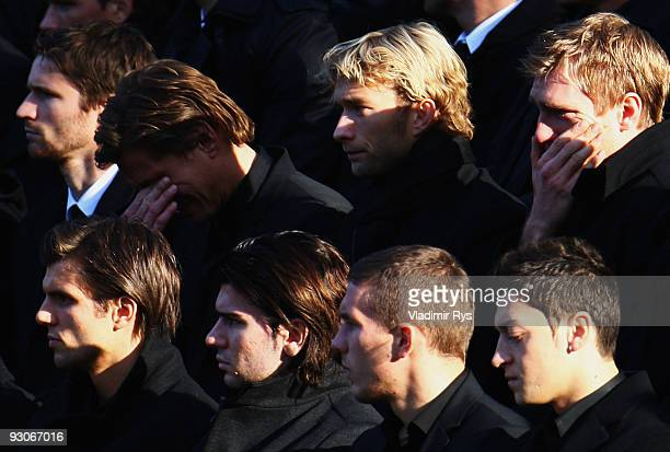 Rene Adler and Per Mertesacker force with the tears at their team mate's Robert Enke memorial service prior to Enke�s funeral at AWD Arena on...