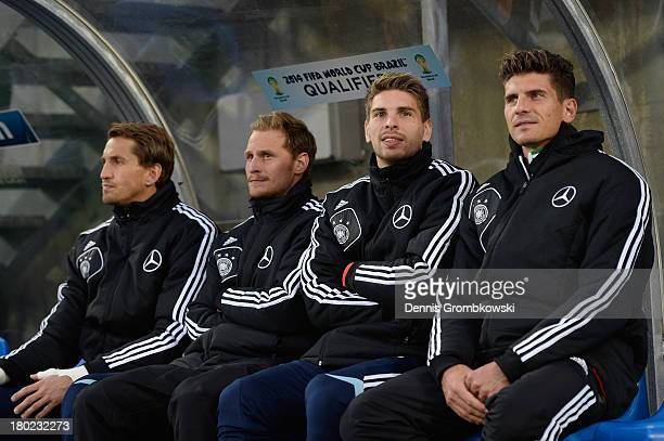Rene Adler of Germany and teammates Benedikt Hoewedes RonRobert Zieler and Mario Gomez sit on the bench prior to the FIFA 2014 World Cup Qualifier...