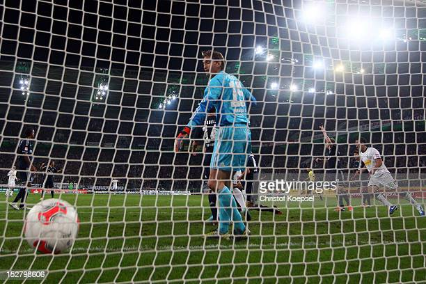 Rene Adler of Hamburg gets the first goal of Martin Stranzl of Moenchengladbach during the Bundesliga match between Borussia Moenchengladbach and...