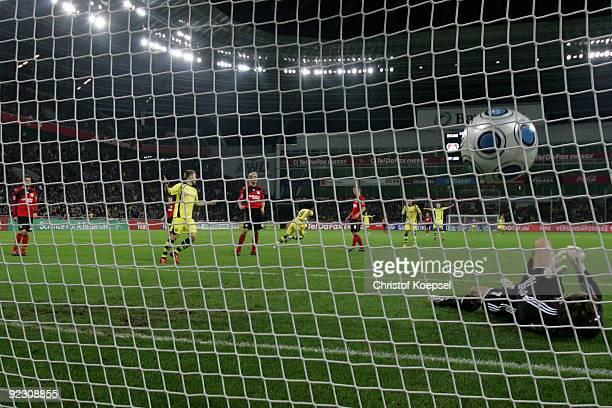 Rene Adler of Leverkusen gets the first goal during the Bundesliga match between Bayer Leverkusen and Borussia Dortmund at the BayArena on October...