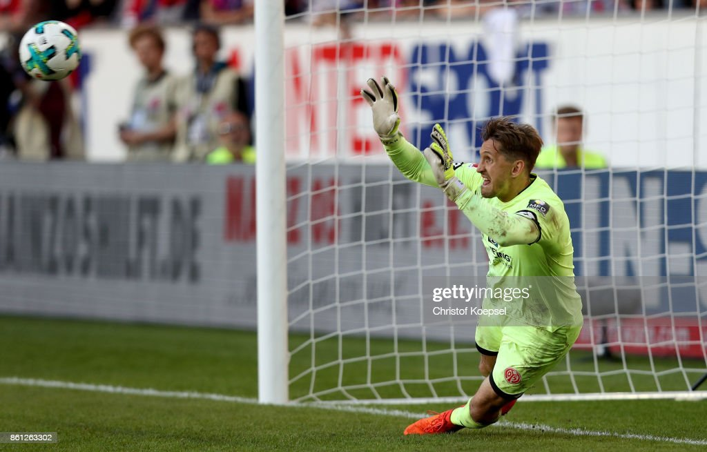 Rene Adler of Mainz gets a penalty goal of Sejad Sahilovic during the Bundesliga match between 1. FSV Mainz 05 and Hamburger SV at Opel Arena on October 14, 2017 in Mainz, Germany.