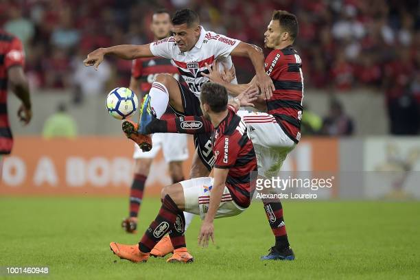 Rene and Diego of Flamengo struggles for the ball with Diego Souza of Sao Paulo during the match between Flamengo and Sao Paulo as part of...