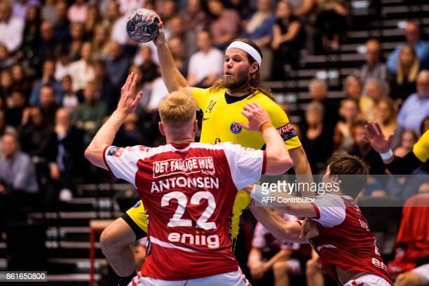 Rene Antonsen of Aalborg Handball blocks Mikkel Hansen of Paris SaintGermain during the Men's Champions League Group Phase Round 5 handball match in...