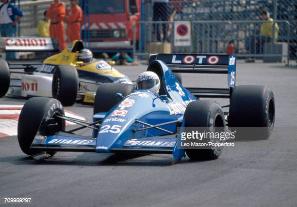 Rene Arnoux of France, driving a Ligier JS33 with a Ford Cosworth DRF V8 engine for Ligier Loto, enroute to placing twelfth during the Monaco F1...