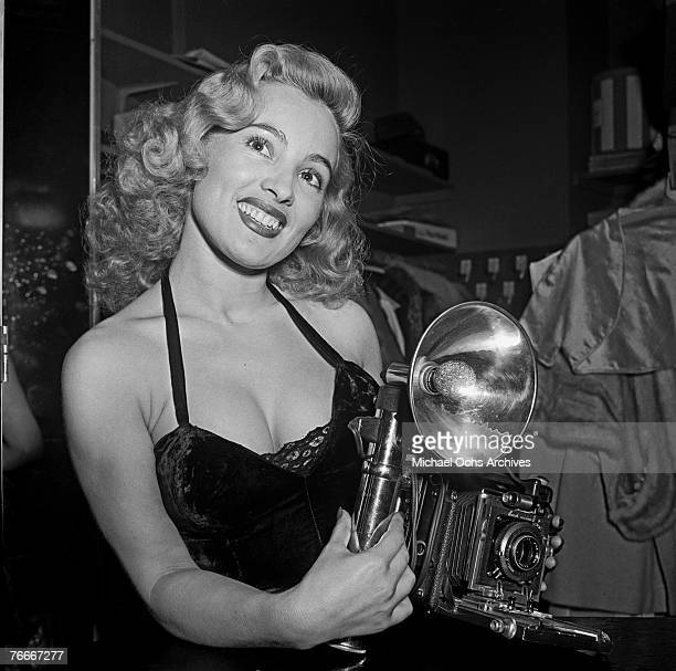 Rene Bartoly, the camera girl, is one of the features of the famous Mocambo nightclub on the Sunset Strip on July 1 in Hollywood, California.