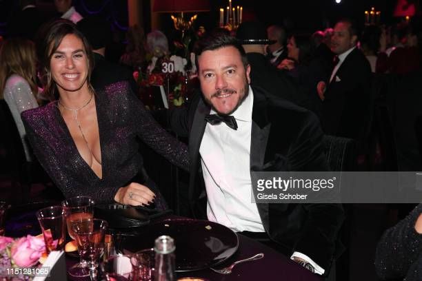 Rene Benko and his wife Nathalie Benko attend the amfAR Cannes Gala 2019 at Hotel du CapEdenRoc on May 23 2019 in Cap d'Antibes France