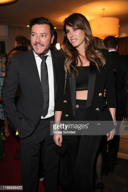Rene Benko and his wife Nathalie Benko during the Schwarzenegger climate initiative charity dinner prior the Hahnenkamm Ski Races at Country Club on...