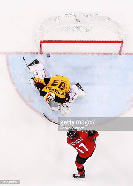 Rene Bourque of Canada looks on as Danny Aus Den Birken of Germany allows a goal by Gilbert Brule of Canada in the second period during the Men's...