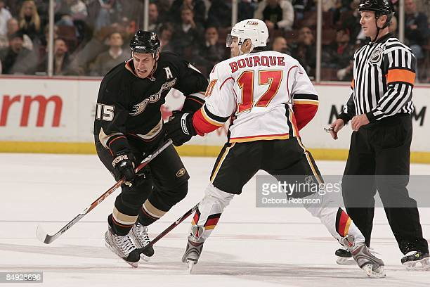 Rene Bourque of the Calgary Flames defends against Ryan Getzlaf of the Anaheim Ducks during the game on February 11 2009 at Honda Center in Anaheim...