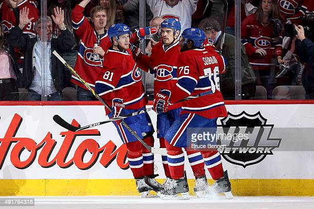 Rene Bourque of the Montreal Canadiens celebrates his second period goal with teammates Lars Eller and P.K. Subban of the Montreal Canadiens against...