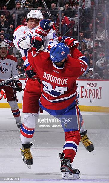 Rene Bourque of the Montreal Canadiens collides with Alex Ovechkin of the Washington Capitals during the NHL game on February 4 2012 at the Bell...