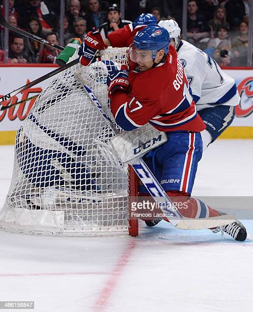 Rene Bourque of the Montreal Canadiens collides with the net of the Tampa Bay Lightning in Game Four of the First Round of the 2014 Stanley Cup...