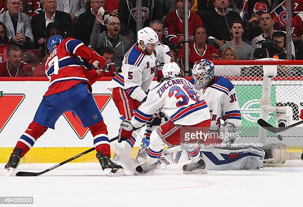 Rene Bourque of the Montreal Canadiens gires the puck past Henrik Lundqvist of the New York Rangers for second period goal at 654 during Game Five of...