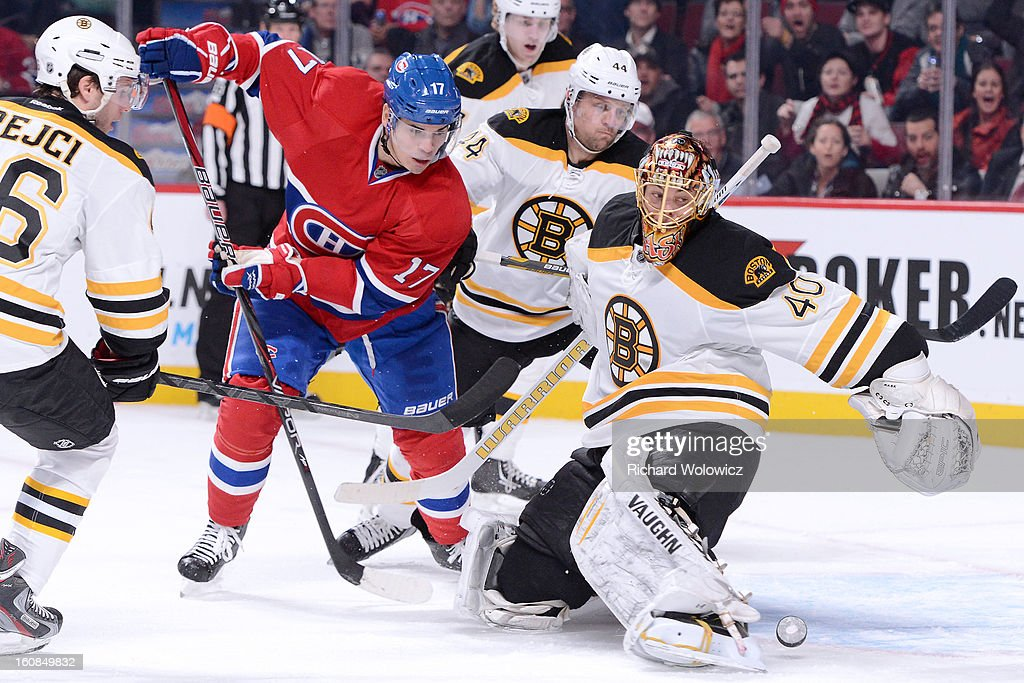 Rene Bourque #17 of the Montreal Canadiens slips the puck past Tuukka Rask #40 of the Boston Bruins but missing goal during an NHL game at the Bell Centre on February 6, 2013 in Montreal, Quebec, Canada.