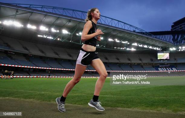 Rene Caris performs in the 2km time trial during the AFLW Draft Combine at Marvel Stadium on October 3 2018 in Melbourne Australia