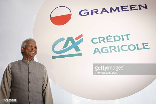Rene Carron CEO of Credit Agricole SA and Mohammad Yunus Chairman of Grameen Bank announce the launch of the Grameen Credit Agricole Microfinance...